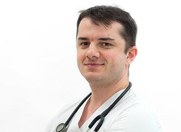 dr. Dinu Andrei DRAGOMIR